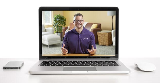 Man in purple shirt presenting virtually