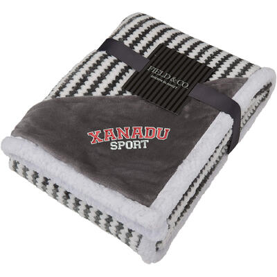 folded gray and white sherpa blanket