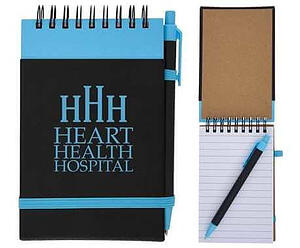 blue spiral jotter notebook with heart health hospital logo and pen