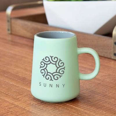 mint colored 15-oz mug with Sunny Logo