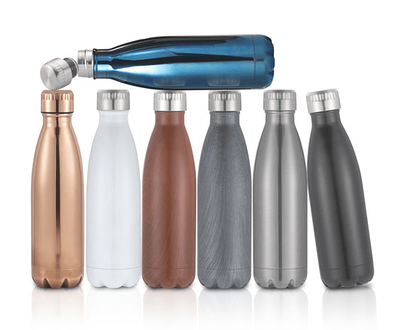 6 Serendipity Water Bottles in a row with 1 blue bottle laying across the tops