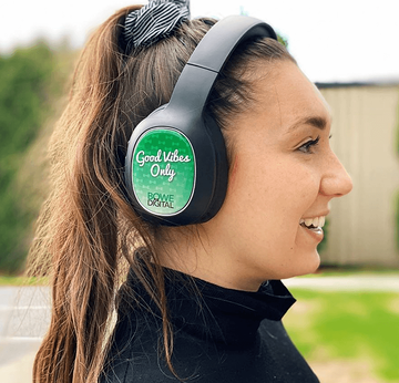 Girl wearing Headphones with good vibes only on ear piece