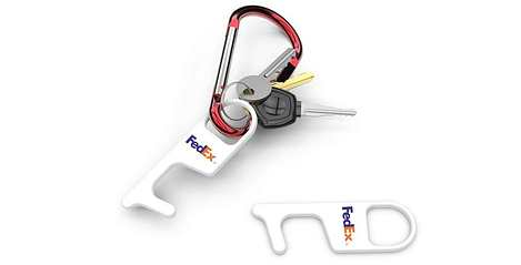 two white touchtools with fedex logo one on a keychain and one on its side